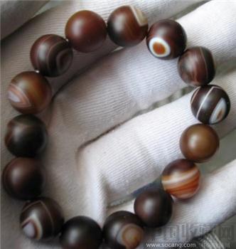 鸡肝色缠丝玛瑙珠手链-收藏网