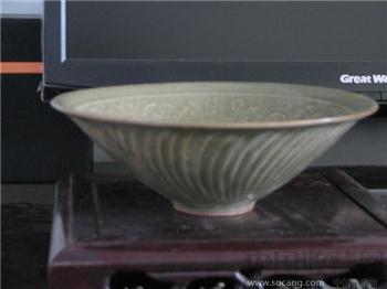 宋 耀州窑青釉浅浮雕婴戏图纹缠枝花卉纹碗-收藏网