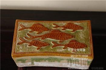 唐三彩鱼纹枕-收藏网