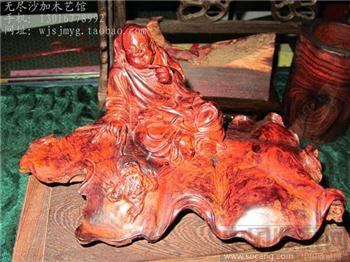 纹理色泽养眼,设计巧妙,纯手工雕刻的海南黄花梨木雕摆件/刘海戏金蟾-收藏网