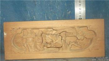 福建木雕,一男一女在奏乐,引来一只山中凤凰-收藏网