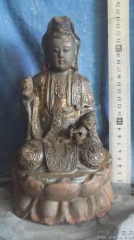 木雕观音像,在寺庙里被香火熏黑了 -收藏网