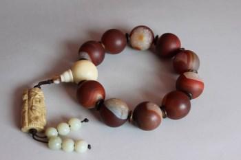 晶心缠丝红玛瑙手珠2-收藏网