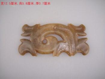 红山勾云形佩-中国收藏网