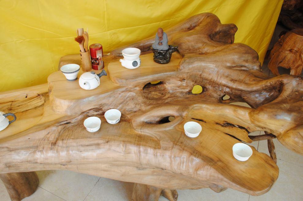 义结金楠工艺品坊主要经营:批发 零售 定做 加工 各种木料 根雕茶几