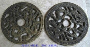 一对镂雕的双龙花钱-中国收藏网